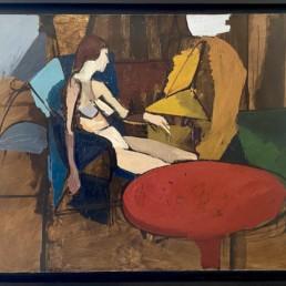 nu alangui de Michel Mousseau peint à l'huile sur toile avec une nature morte dont une table rouge d'un grand colorisme.